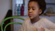 Girl Eating Homemade Cupcakes At Table Shot On R3D video