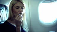 Girl eating in airplane video
