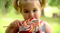 Girl eating lollipop. Slow motion. video