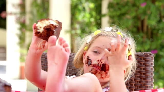 Girl Eating Messy Slice Of Chocolate Cake video