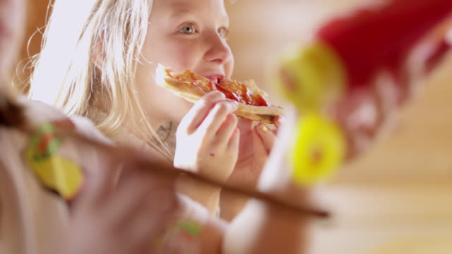 MS Girl eating slice of pizza video