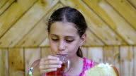 Girl eats bread and drinks tea video
