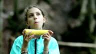 Girl eats corn video
