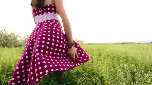 Girl enjoy in spring green field video