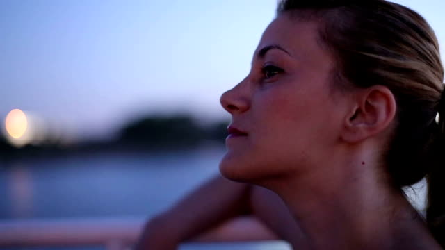 girl enjoying a boat ride at night video