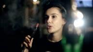 Girl enjoying smoking hookah in a night cafe video