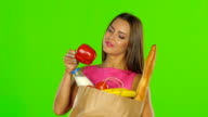Girl enjoying the aroma of the products. Green screen. Close up video