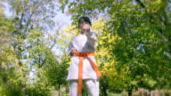 Girl exercise karate in park video