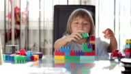 Girl Exploring Block Toys video