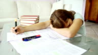 Girl falling asleep because of too much studying video