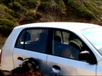 Girl feeding hungry goat  from iniside a car video