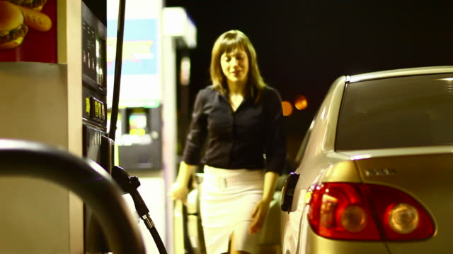 Girl filling up a car video