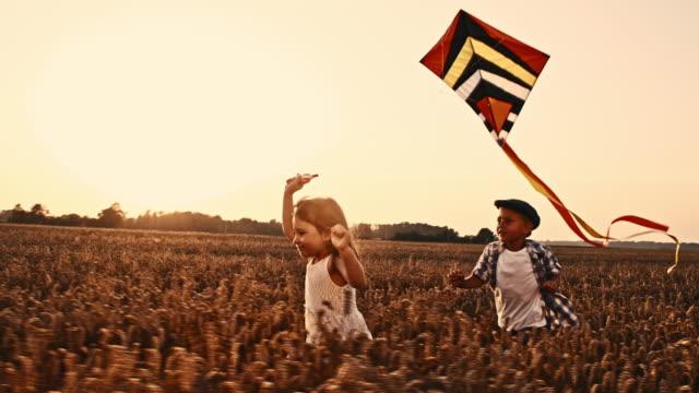 SLO MO Girl flying a kite video