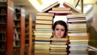 Girl gazing through books video