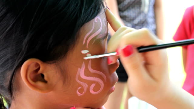 Girl Gets Face Painting At Carnival video
