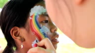 Girl Gets Rainbow Face Painting video