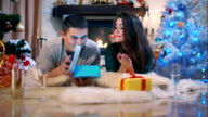 Girl givng a Christmas gift to her boyfriend video