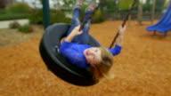 Girl goes big on tire swing video