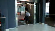 Girl goes into elevator and moves down video