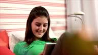 girl handling a tablet video