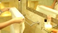 girl hangs a towel in the bathroom video