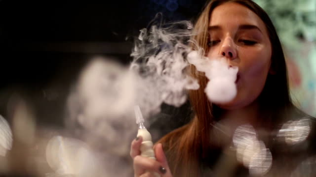 Girl has a rest in a cafe smokes a hookah video