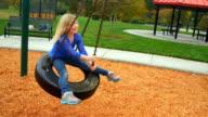 Girl has fun on tire swing video