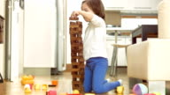 Girl Having Fun Stacking Blocks video