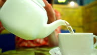Girl having her green tea in a cafe, close up shot video