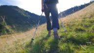 Girl hiking in mountain fields video