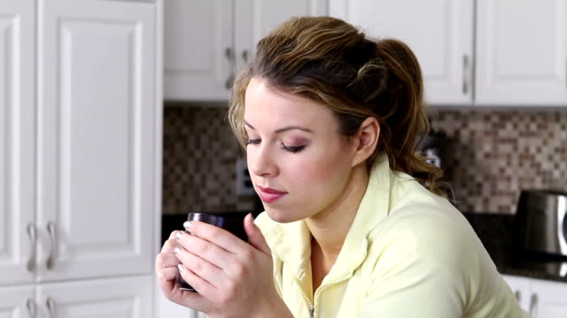 Girl holding coffee cup video