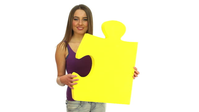 girl holding jigsaw puzzle pieces video