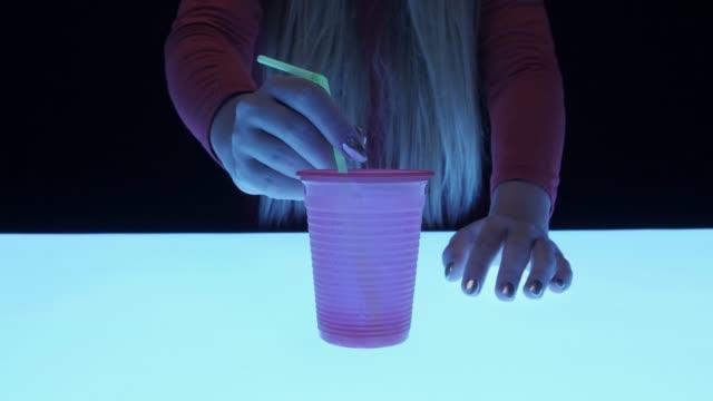 Girl Holding Plastic Glass. Futuristic Mood video