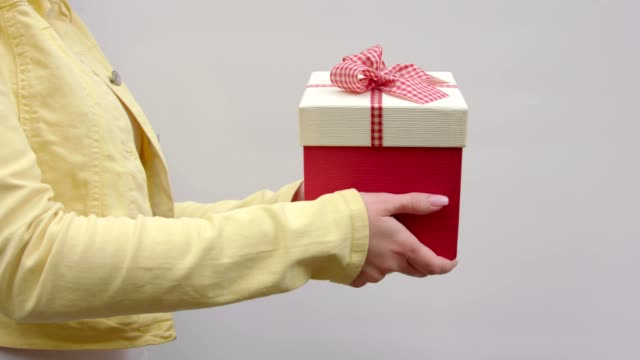 A girl holds out a gift from right to left video