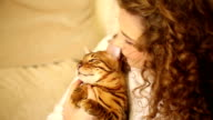 Girl hugging and playing with Bengal cat. Laugh. video