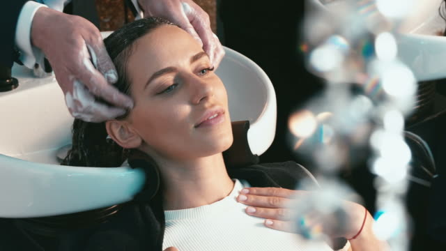 Girl in a beauty salon wash the head video