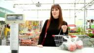 girl in a garden centre makes shopping video
