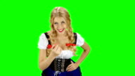 Girl in bavarian costume seductive beckoning by finger to herself. Green screen video