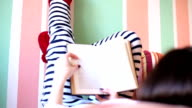 Girl in bed  reading a book video