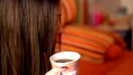 Girl in bed with coffee cup video