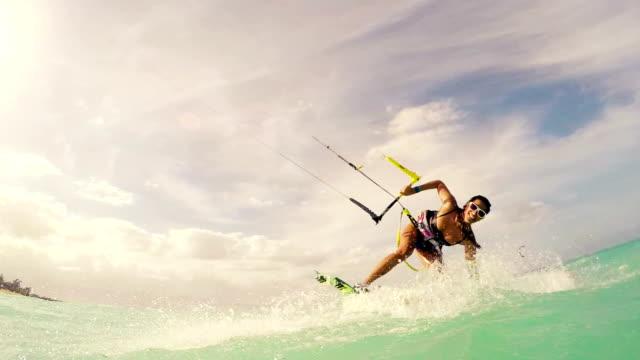 Girl in Bikini Kitesurfing in Ocean. Summer Fun in the Ocean. video