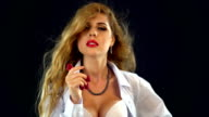 Girl in business suit unbuttoned her blouse. FullHD video