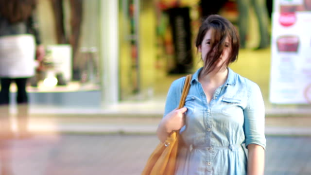 Girl in front of shopping mall video
