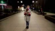Girl in real time using tablet on the street timelapse background. video