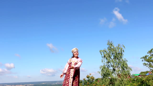Girl in Russian folk costume welcomes video