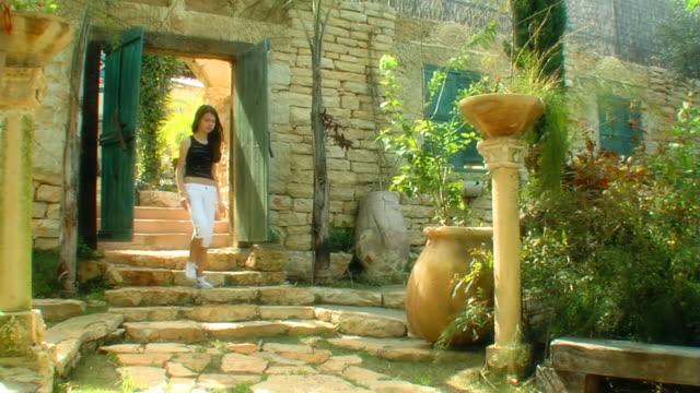 Girl in the old fairy tale castle yard video