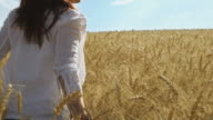 Girl in wheat field. video