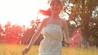 SLO MO TS Girl in white dress running in meadow video
