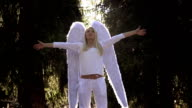 Girl in White with Angel Wings video