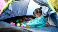 Girl is playing ball in tent video